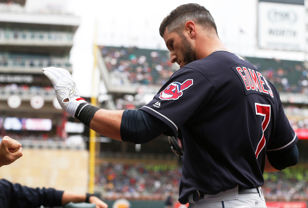 . Cleveland Indians\' Yan Gomes is congratulated in the dugout after his three-run home run off in the eighth inning of the first game of a baseball doubleheader Thursday, Aug. 17, 2017, in Minneapolis. The Indians won 9-3. (AP Photo/Jim Mone)