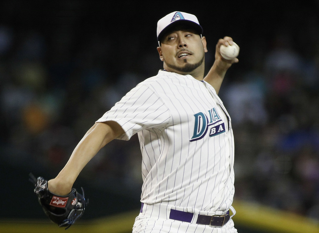 . Starting pitcher Vidal Nuno #54 of the Arizona Diamondbacks delivers a pitch against the Colorado Rockies during the first inning of a MLB game at Chase Field on August 30, 2014 in Phoenix, Arizona. (Photo by Ralph Freso/Getty Images)