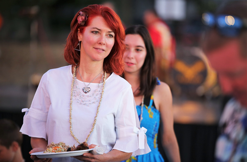 Guests enjoying food served at Becoming Independents 4th annual luau Held on Saturday September 23rd in Becoming Independents garden. Guests enjoyed Polynesian dancing, live music, raffles, signature drinks and luau feast while supporting vital programs in this fundraiser. (Photos Will Bucquoy for the Press Democrat).