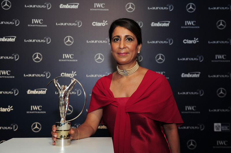 . Laureus Academy Member Nawal El Moutawakel poses with the trophy at the 2013 Laureus World Sports Awards at the Theatro Municipal Do Rio de Janeiro on March 11, 2013 in Rio de Janeiro, Brazil.  (Photo by Jamie McDonald/Getty Images For Laureus)