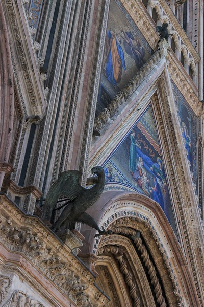 Orvieto Cathedral is the tallest point in a city built on an easily defended mountain of volcanic rock. Visitors cannot drive in and must ride a vernicular up and into the city.