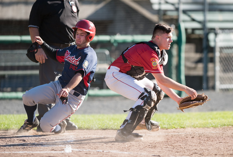 06/25/18  Wesley Bunnell | Staff  Bristol Legion baseball vs Winsted on Monday evening at Muzzy Field. Catcher Jeremy Ganavage (8) readies to field the throw from the right fielder Michael Lemke (1) but the runner would beat the throw.