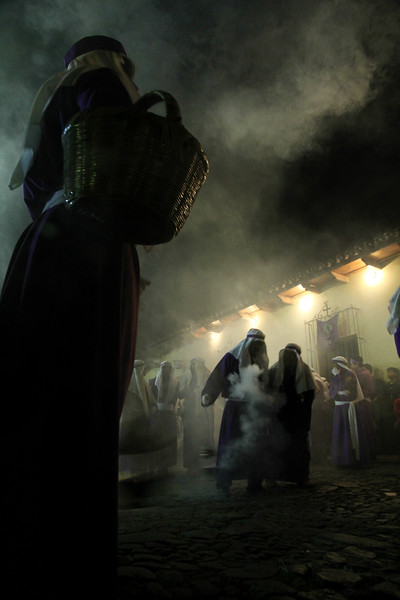 Processioners send incense into the air in front of the final display as it arrives at Iglesia La Merced in Antigua, Guatemala on March 24, 2013. Photo by Scott Umstattd