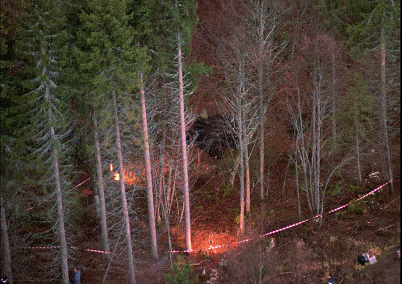 . View from a helicopter, of the forest in which 16 charred members of the doomsday cult The Order of the Solar Temple were found in star formation around a campfire, seen at center in black, in Saint Pierre de Cherennes, French Alps, Saturday December 23, 1995. The deaths were the latest among members of the Swiss-based cult, a year after 53 other members were found dead in an apparent mass murder-suicide in Switzerland and Quebec. It is believed the group thought the end of the world would come in the mid-1990s and they had to achieve a higher spiritual plane by taking their lives before then. (AP PHOTO/Michel Lipchitz)