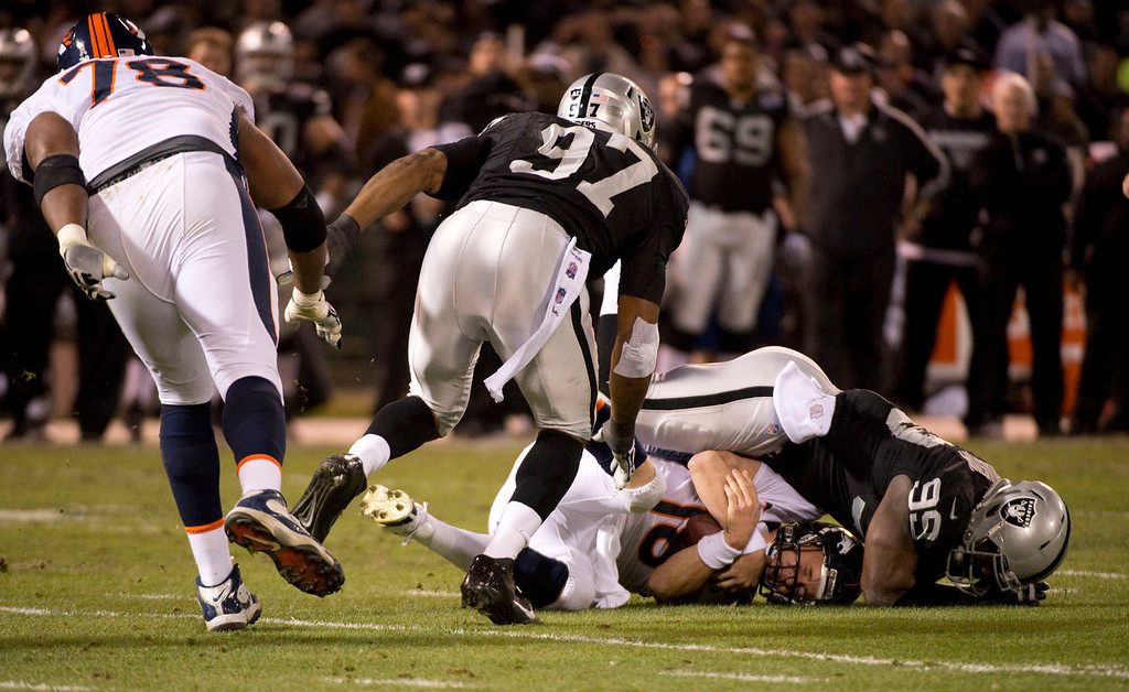 . Oakland Raiders linebacker Kaelin Burnett (95) sacks Denver Broncos quarterback Peyton Manning (18) during the first quarter Thursday, December 6, 2012 during Thursday Night Football at O.c Coliseum in Oakland  John Leyba, The Denver Post