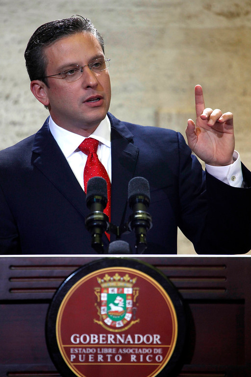 . Puerto Rico Gov. Alejandro Garcia Padilla speaks during a state of the commonwealth address at the Capitol building in San Juan, Puerto Rico, Thursday, April 25, 2013. Garcia Padilla  unveiled a $9.8 billion operating budget Thursday night in which he pledged to reduce crime, create jobs, boost school attendance and expand the U.S. territory\'s tourism sector. Padilla said he plans to reduce the island government\'s $2.2 billion deficit to $775 million in one year, in part by taxing those who earn $200,000 or more a year or who buy homes valued at $1 million or more. (AP Photo/Ricardo Arduengo)