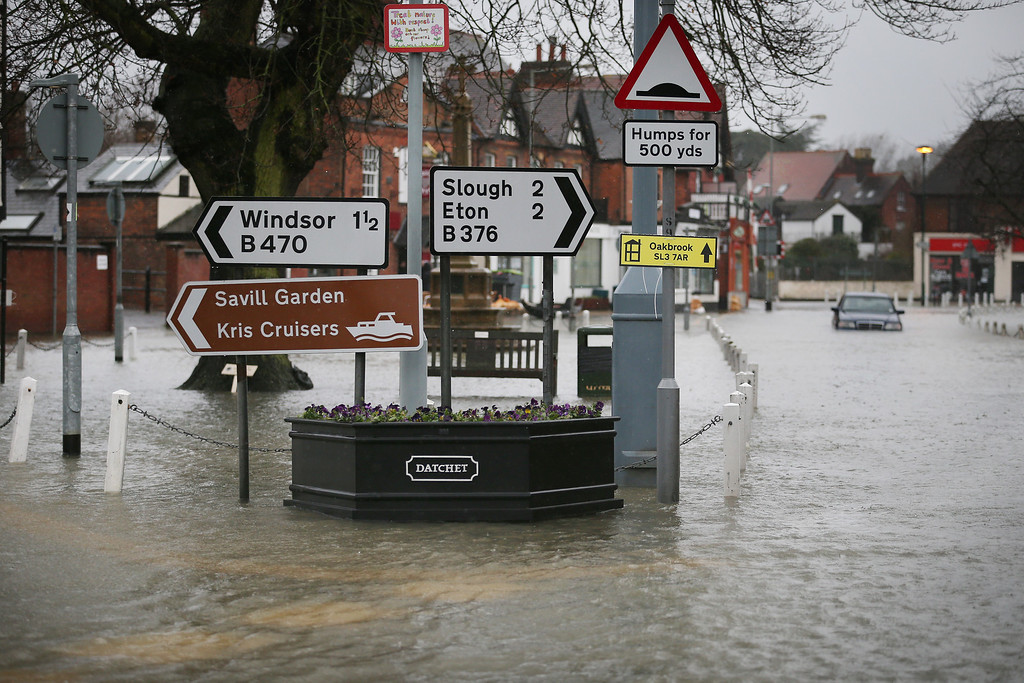 . Flood water fills the High Street on February 12, 2014 in Datchet, England.The Environment Agency contiues to issue severe flood warnings for a number of areas on the river Thames in the commuter belt west of London. With heavier rains forecast for the coming week people are preparing for the water levels to rise.  (Photo by Peter Macdiarmid/Getty Images)