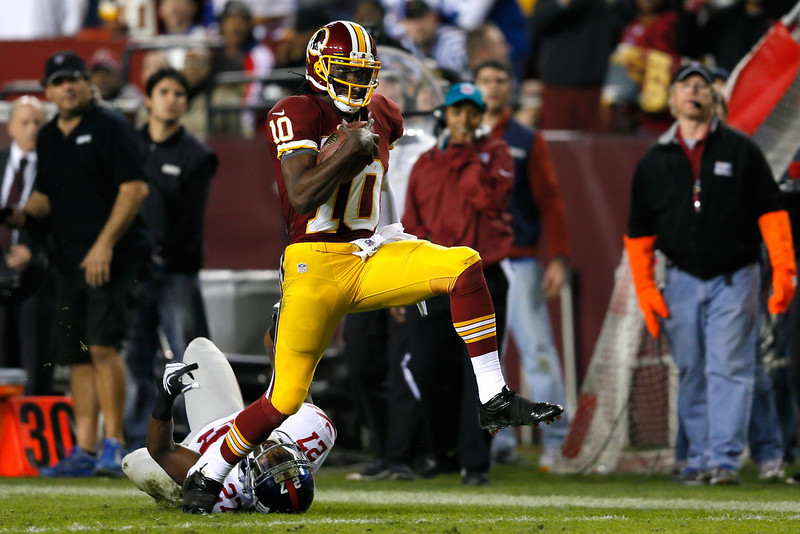 . Robert Griffin III, Baylor Selected second overall by the Redskins in 2012 The AP Offensive Rookie of the Year in 2012, Griffin III passed for 3,200 yards, rushed for 815 yards and led the Redskins to an NFC East title and playoff berth. Griffin�s season ended on a low note when he tore his ACL in the NFC playoffs against fellow rookie quarterback Russell Wilson and the Seahawks.  GRADE: A-. Has the skills of a franchise quarterback, but will his playing style shorten his NFL career? (Photo by Rob Carr/Getty Images)