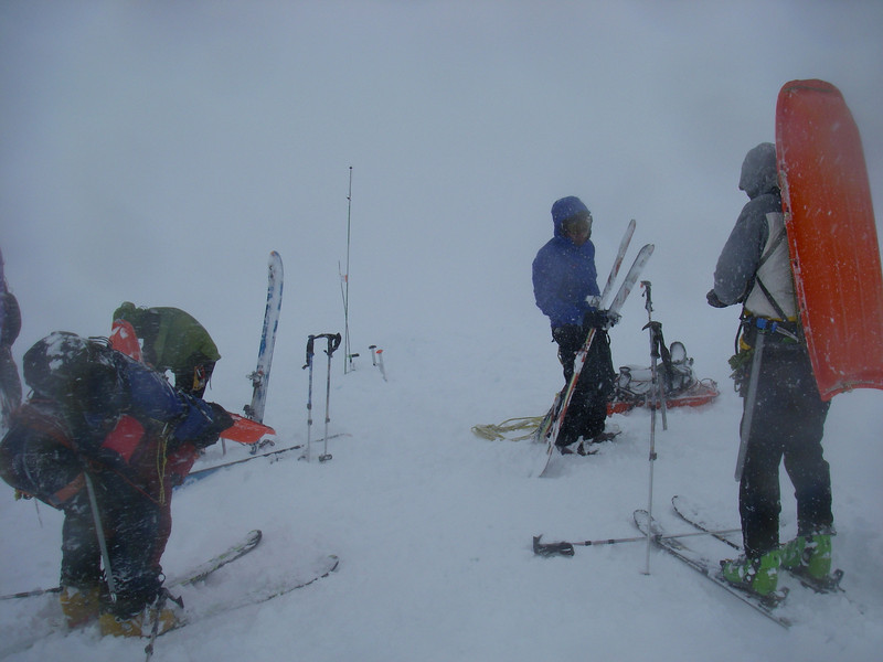 Whiteout conditions - rain turned into snow just as we reached the cash-in spot. From left: Tim, Durny, Doug, and John DM.