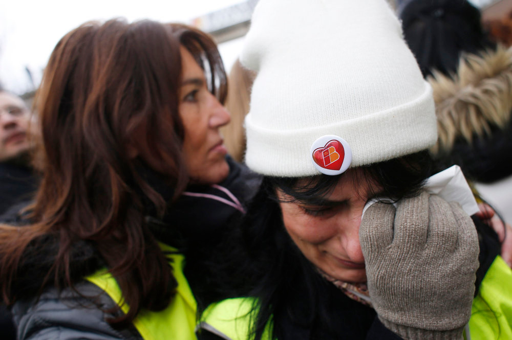 ". Maria Francisca Sanchez, who has been working for Iberia airlines for 27 years, cries during a protest at Madrid\'s Barajas airport February 18, 2013. Striking union workers clashed with police at the airport on Monday on the first day of a week-long strike over more than 3,800 pending job cuts at Spain\'s flagship airline Iberia. The pin on Sanchez\'s hat reads, ""Let\'s save Iberia\"". REUTERS/Susana Vera"