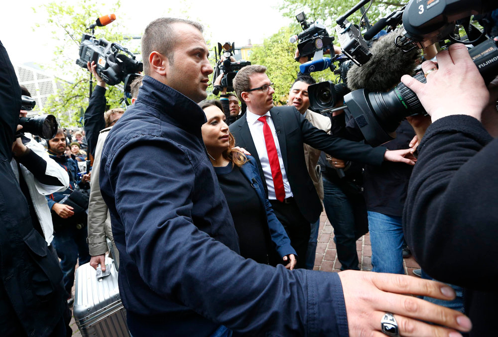 . Semiya Simsek (C) and her brother Enver (L), children of NSU victim Enver Simsek arrive at the courthouse in Munich May 6, 2013. The surviving member of the NSU blamed for a series of racist murders that scandalized Germany and shamed its authorities goes on trial on Monday in one of the most anticipated court cases in recent German history. The trial in Munich will focus on 38-year-old Zschaepe, who is charged with complicity in the murder of eight Turks, a Greek and a policewoman between 2000-2007, as well as two bombings in immigrant areas of Cologne, and 15 bank robberies. REUTERS/Michaela Rehle