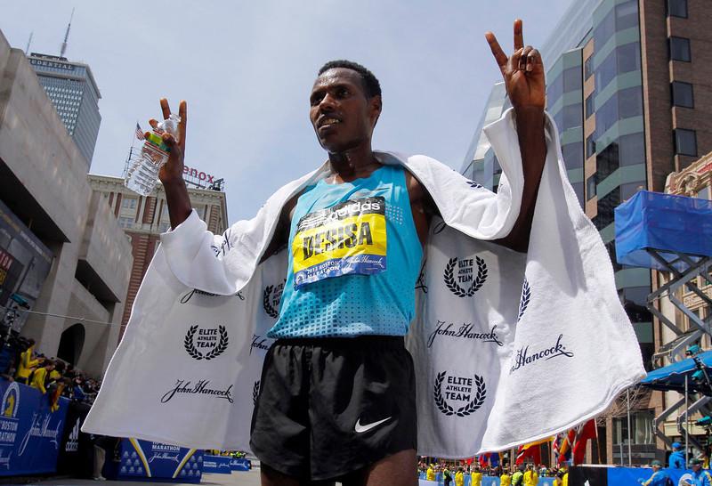 . Men\'s division winner Lelisa Desisa Benti of Ethiopia poses for a photo after winning the men\'s division of the 117th Boston Marathon in Boston, Massachusetts April 15, 2013. REUTERS/Jessica Rinaldi