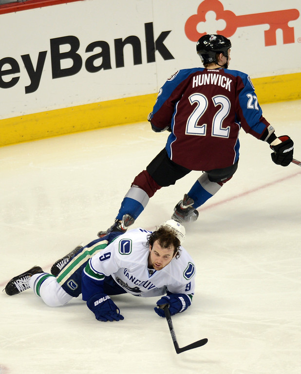 . DENVER, CO. - APRIL 13 : Matt Hunwick of Colorado Avalanche (22) checks Zack Kassian of Vancouver Canucks (9) in the 2nd period of the game at Pepsi Center. Denver, Colorado. April 13, 2013. (Photo By Hyoung Chang/The Denver Post)