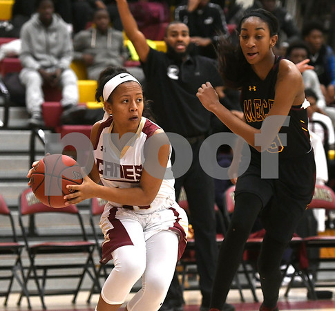 1/13/2018 Mike Orazzi | Staff New Britain's Saniya Pellegrini (11) and Medgar Evers College Preparatory School's Shequana Jackson (3) in New Britain Saturday afternoon.