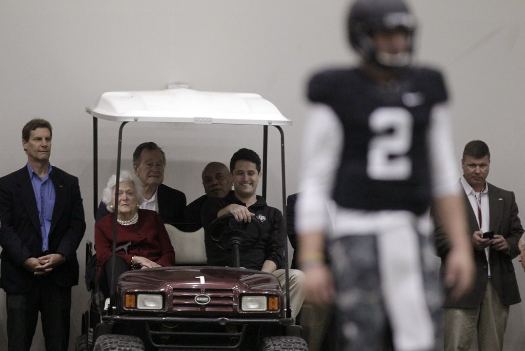 """. <p><b> Dozens of NFL coaches, reporters and celebrities turned out last week for Manziel�s pro day workout at Texas A&M, proving once and for all that � </b> <p> A. The Heisman Trophy winner is the biggest name in the upcoming NFL draft <p> B. Team officials still have lingering questions about the star quarterback <p> C. Former President Bush has WAY too much free time on his hands <p><b><a href=\'http://q.usatoday.com/2014/03/31/nfl-johnny-manziel-nfl-draft-minnesota-vikings-mike-zimmer/\' target=\""""_blank\"""">HUH?</a></b> <p>    (AP Photo/Patric Schneider)"""