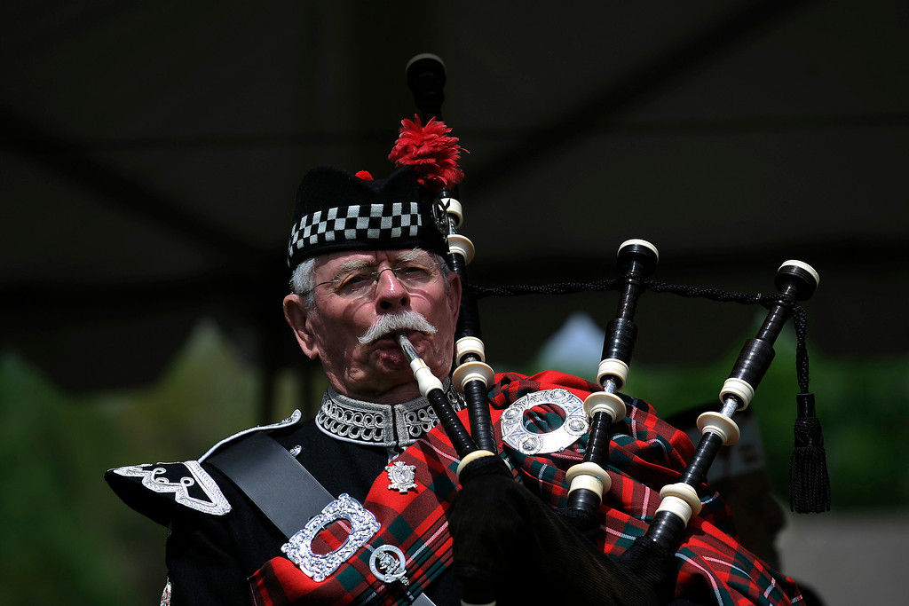 . Ken Giese plays Amazing Grace on the bagpipes during a Memorial Day ceremony at Fort Logan Cemetery in Denver, Colorado on May 26, 2014. (Photo by Seth McConnell/The Denver Post)