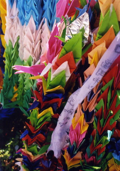 Streams of folded paper cranes sent by children to Nagasaki to help facilitate healing.