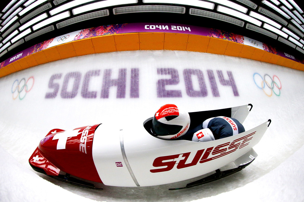. Pilot Beat Hefti and Alex Baumann of Switzerland team 1  make a run during the Men\'s Two-Man Bobsleigh heats on Day 9 of the Sochi 2014 Winter Olympics at Sliding Center Sanki on February 16, 2014 in Sochi, Russia.  (Photo by Al Bello/Getty Images)