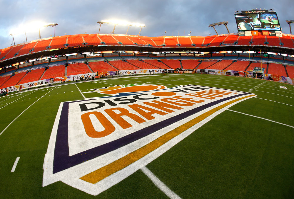 Description of . A detail of the Orange Bowl logo on the field prior to Florida State Seminoles playing against the Northern Illinois Huskies during the Discover Orange Bowl at Sun Life Stadium on January 1, 2013 in Miami Gardens, Florida.  (Photo by Chris Trotman/Getty Images)