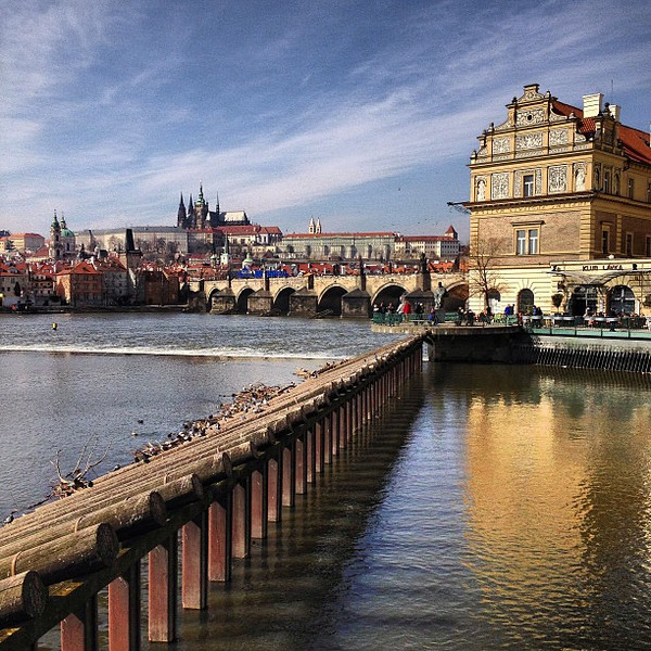 Prague: our old stomping grounds. As freezing and beautiful as I remember. (when the sun shines). Prague Castle background, Smetana Museum and Vltava River foreground