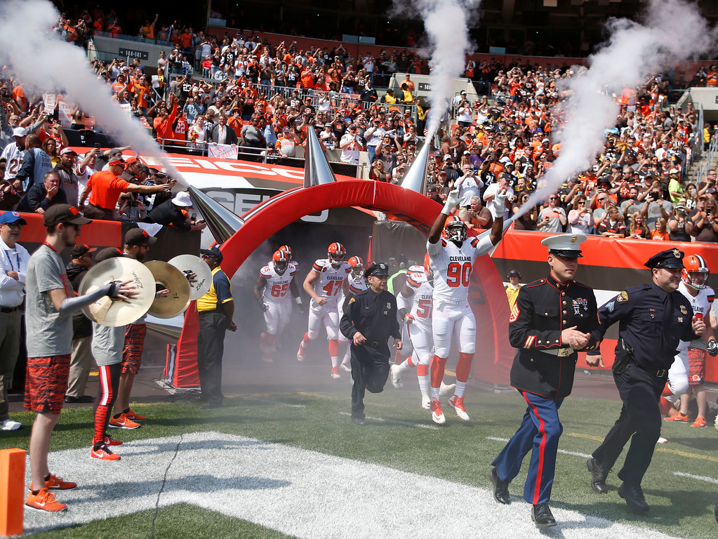 . Cleveland Browns players and members of the Cleveland police and military personnel run out on the field together before an NFL football game between the Pittsburgh Steelers and the Cleveland Browns, Sunday, Sept. 10, 2017, in Cleveland. (AP Photo/Ron Schwane)