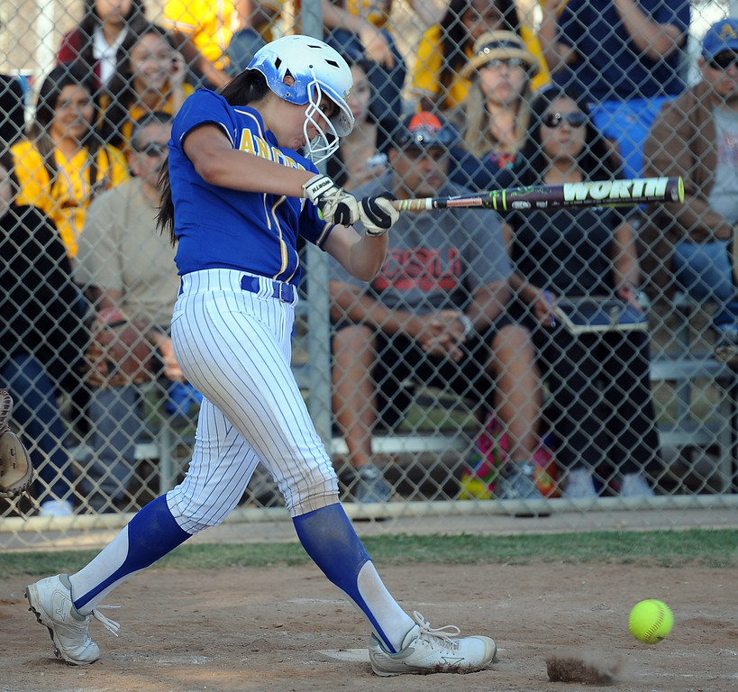 . Bishop Amat\'s Amanda Sanchez watches her RBI single as Eryn Sustayta (not pictured) scores the go ahead run in the sixth inning of a prep softball game against Santiago at Bishop Amat High School on Wednesday, March 27, 2013 in La Puente, Calif. Bishop Amat won 5-3.  (Keith Birmingham Pasadena Star-News)