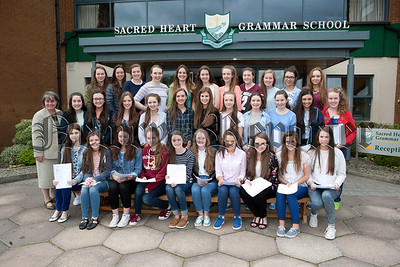 Sacred Heart Principal Sr Julie McGoldrick is pictured with students who recieved their GCSE results. R1436004