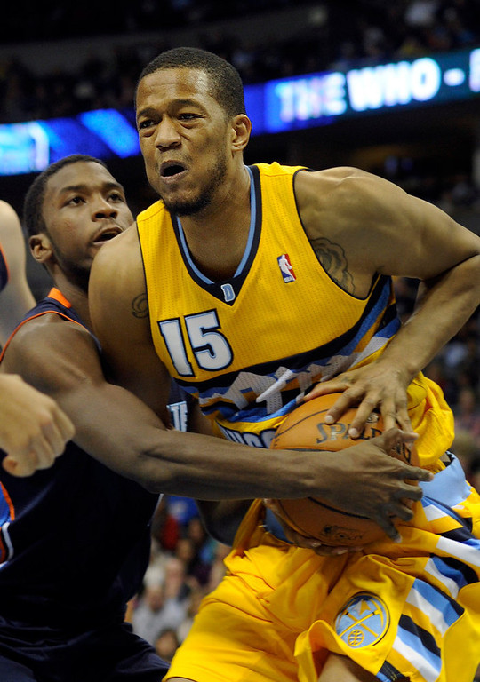 . Denver forward Anthony Randolph (15) got tied up with Bobcats forward Michael Kidd-Gilchrist (14) in the second half. The Denver Nuggets defeated the Charlotte Bobcats 110-88 at the Pepsi Center Saturday night, December 22, 2012.  Karl Gehring/The Denver Post