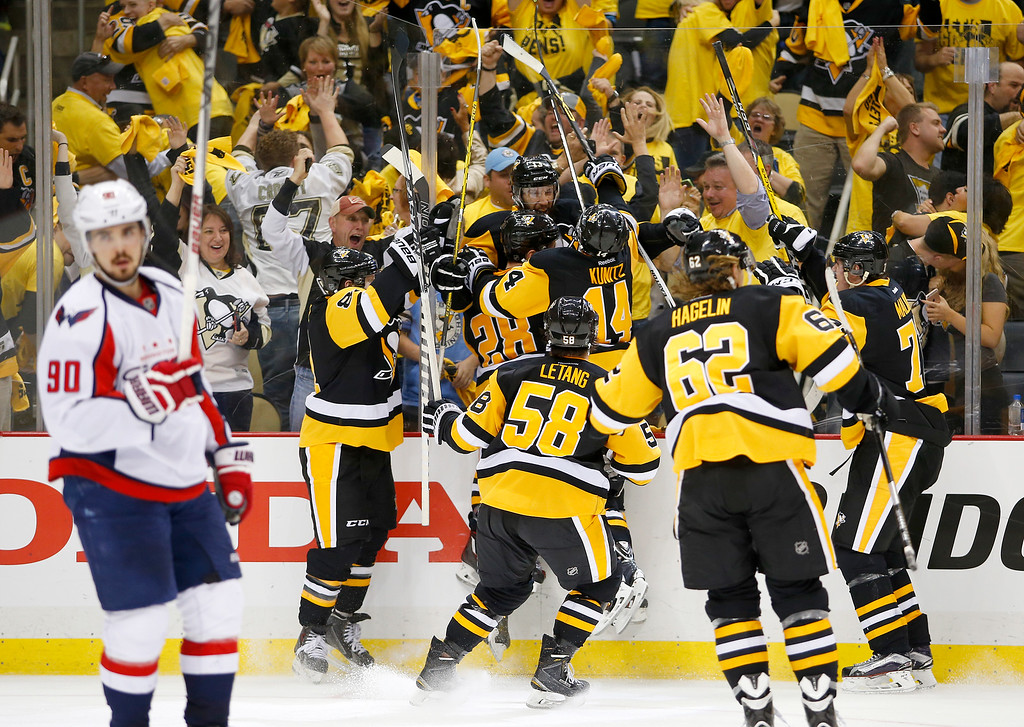 . PITTSBURGH, PA - MAY 10:  Nick Bonino #13 of the Pittsburgh Penguins celebrates his game winning overtime goal against the Washington Capitals in Game Six of the Eastern Conference Second Round during the 2016 NHL Stanley Cup Playoffs at Consol Energy Center on May 10, 2016 in Pittsburgh, Pennsylvania.  (Photo by Justin K. Aller/Getty Images)