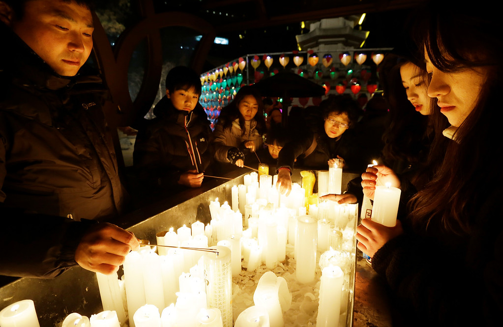 . Buddhists light candles during New Year celebrations at Jogye Buddhist temple in Seoul, South Korea, Thursday, Jan. 1, 2015. (AP Photo / Ahn Young-joon)