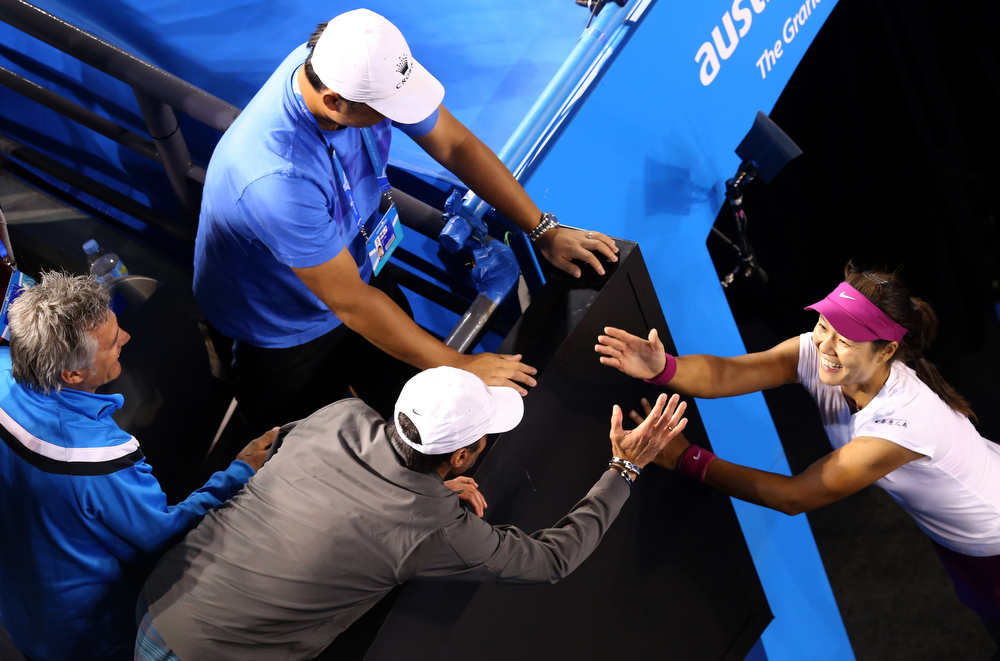 . Li Na of China celebrates with her husband Jiang Shan, center top, and support team members after defeating Dominika Cibulkova of Slovakia during their women\'s singles final at the Australian Open tennis championship in Melbourne, Australia, Saturday, Jan. 25, 2014.(AP Photo/Eugene Hoshiko)