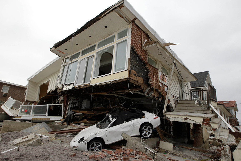 . A beachside house, deemed uninhabitable by the New York City Department of Buildings, is left in ruins in the Belle Harbor neighborhood of the Rockaways, in New York on Nov. 19, 2012. More than three decades before Superstorm Sandy, a state law and a series of legislative reports began warning New York politicians to prepare for a storm of historic proportions, spelling out scenarios eerily similar to what actually happened. (AP Photo/Kathy Willens, File)
