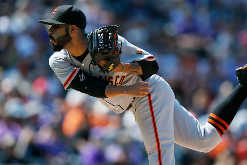 . San Francisco Giants relief pitcher Sergio Romo works against the Colorado Rockies in the eighth inning of the Giants\' 4-2 victory in a baseball game in Denver on Monday, Sept. 1, 2014. The game was resumed in the bottom of the sixth inning of play when it was suspended because of rain on May 22. (AP Photo/David Zalubowski)