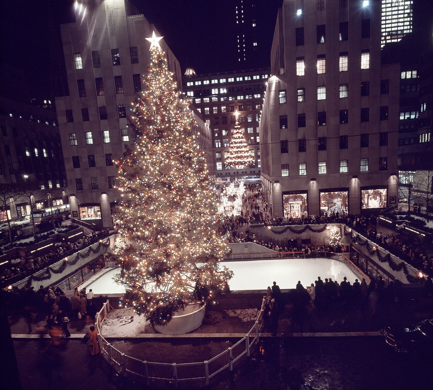 . Rockefeller Center is ablaze with Christmas lights on the tree and in Channel Gardens (background) in New York, 1969. (AP Photo)