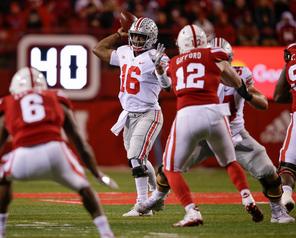. Ohio State quarterback J.T. Barrett (16) throws during the second half of an NCAA college football game against Nebraska in Lincoln, Neb., Saturday, Oct. 14, 2017. Ohio State won 56-14. (AP Photo/Nati Harnik)