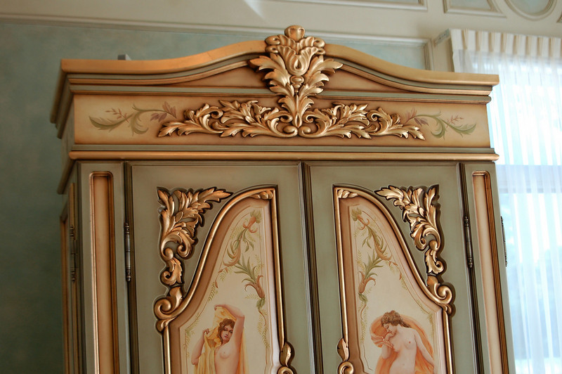 hand-painted 'french armoire' with goldleaf gilding, panels featuring bathing figures produced in oils