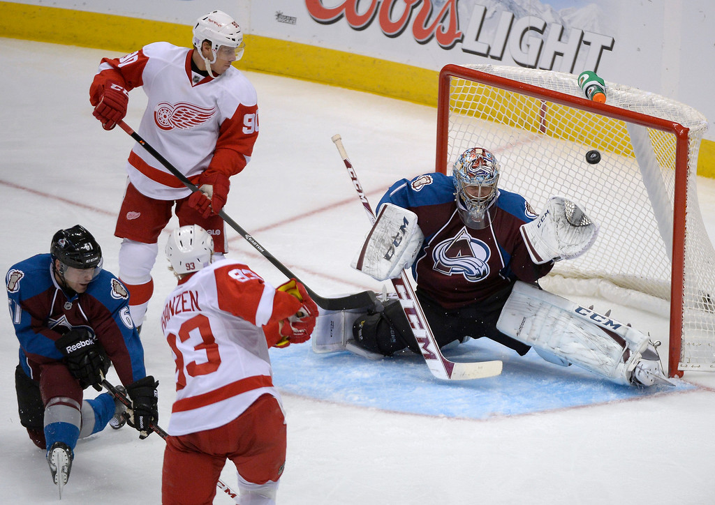 . Detroit Red Wings left wing Johan Franzen (93) scores a goal on a shot ver the glove side of Colorado Avalanche goalie Semyon Varlamov (1) during the third period  October 17, 2013 at Pepsi Center. Detroit defeated Colorado 4-2. (Photo by John Leyba/The Denver Post)