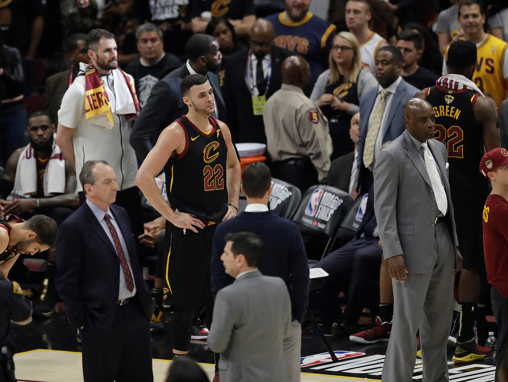 . Cleveland Cavaliers\' Larry Nance Jr. (22) stnads on the court following Game 4 of basketball\'s NBA Finals against the Golden State Warriors, Friday, June 8, 2018, in Cleveland. The Warriors defeated the Cavaliers 108-85 and swept the series. (AP Photo/Tony Dejak)