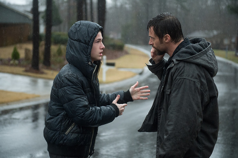 Description of . Dylan Minnette as Ralph Dover and Hugh Jackman as Keller Dover in 'Prisoners.' (Wilson Webb/Warner Bros. Pictures)