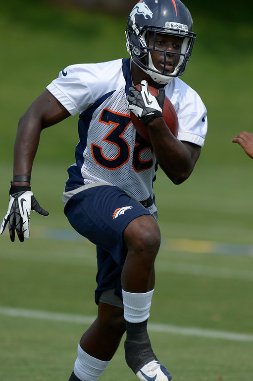 . Montee Ball (38) RB of the Denver Broncos runs through drills during the last day of minicamp June 13, 2013 at Dove Valley. (Photo By John Leyba/The Denver Post)