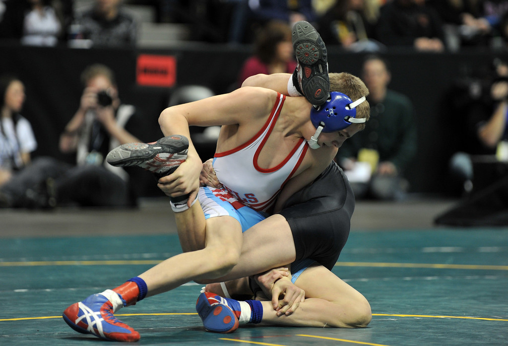 . DENVER, CO. - FEBRUARY 23: Dalton Robertson of Weld Central High School, left, controls Sam Turner of Discovery Canyon High School during 106 pound class 4A final of High School State Championship at Pepsi Center February 23, 2013. Robertson won.  Denver, Colorado. (Photo By Hyoung Chang/The Denver Post)