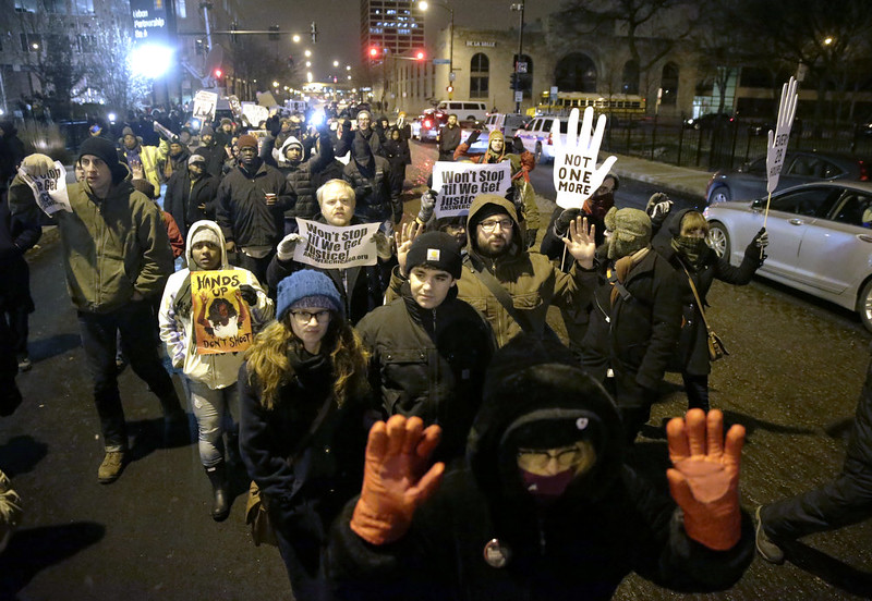 . Protesters march during a rally near the Chicago Police headquarters after the announcement of the grand jury decision not to indict Ferguson police officer Darren Wilson in the fatal shooting of Michael Brown, an unarmed black 18-year old, Monday, Nov. 24, 2014, in Chicago. (AP Photo/Charles Rex Arbogast)