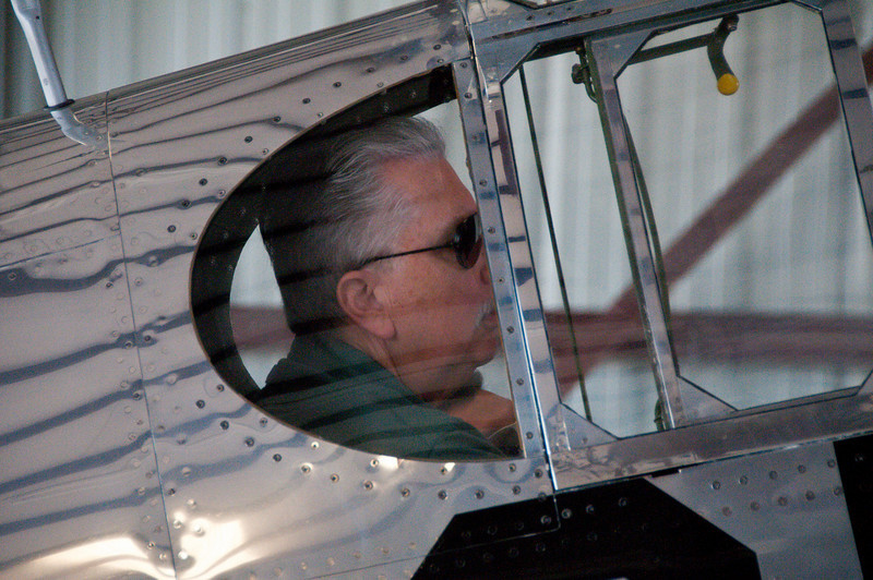 """Gary seated in """"Betty Jane"""" in the hangar prior to pushback."""