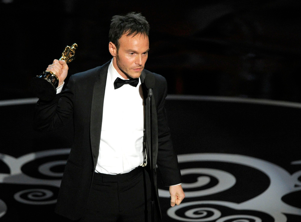 Description of . Chris Terrio accepts the award for best adapted screenplay for