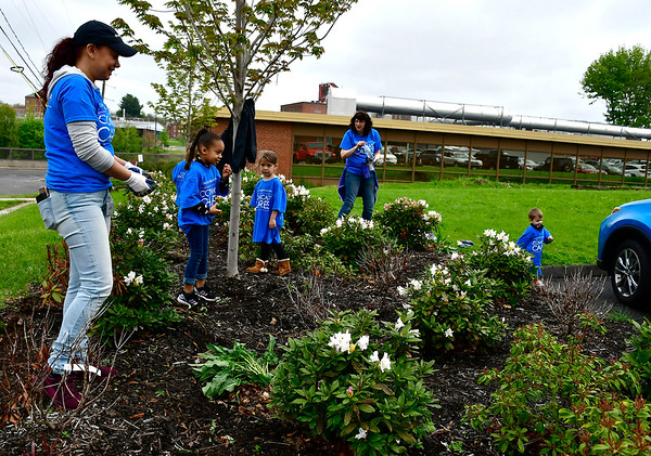 5/4/2019 Mike Orazzi   Staff Comcast's Michelle Gonzales (left) while cleaning up the New Britain Berlin YMCA as part of the 18th annual Comcast Cares Day on High Street in New Britain Saturday.