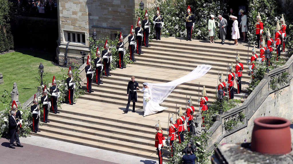 . Britain\'s Prince Harry and Meghan Markle leave after their wedding ceremony at St. George\'s Chapel in Windsor Castle in Windsor, near London, England, Saturday, May 19, 2018. (Andrew Matthews/pool photo via AP)
