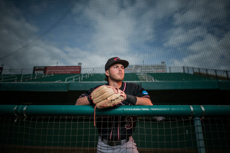 Chico State Wildcat's baseball third basemen, Cameron Santos, 21 year-old Junior from San Ramon, CA has had an outstanding record at bat, led the 2016 team in triples and stolen bases, and was named Second Team All-CCAA selection. Santos is photographed at Nettleton Stadium on Monday, April 24, 2017 in Chico, Calif. Santos was diagnosed with Type 1 Diabetes. Off the field, Santos is a member of the Student-Athlete Advisory Committee and takes part in giving back to the community of Chico with canned food drives, community cleanups, and elementary school fundraisers that help improve the lives of people who are less fortunate. (Jason Halley/University Photographer)