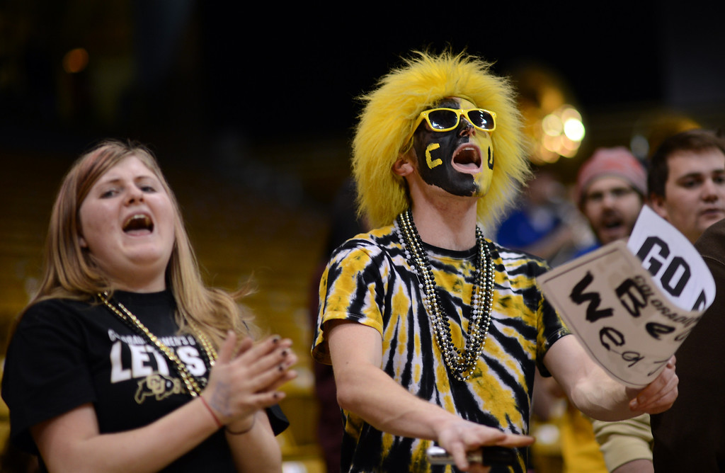 . BOULDER, CO. - MARCH 23: Colorado Buffaloes fans Jennifer Baumann, 18, left, and John Grotenhuis, 20, cheer the team during the first round of the 2013 NCAA women\'s Basketball Tournament game against Kansas Jayhawks at Coors Events Center. Boulder, Colorado. March 23, 2013. (Photo By Hyoung Chang/The Denver Post)
