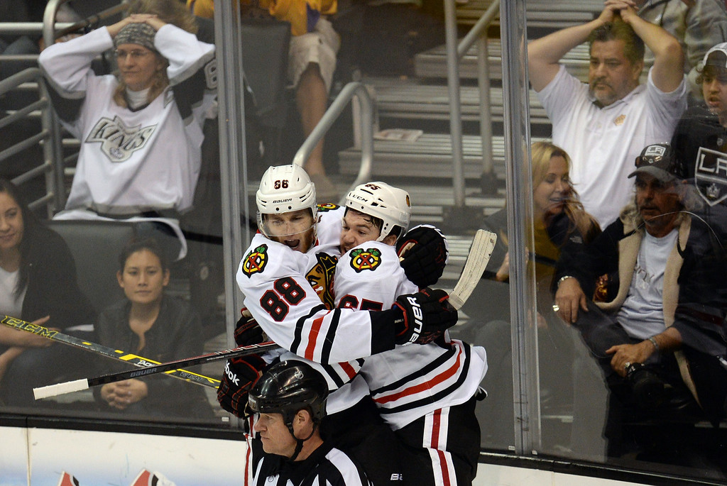 . Blackhawks� Andrew Shaw #65 and Patrick Kane #88 celebrate Kane\'s game winning goal in the third period during Game 6 of the Western Conference finals against the Kings at the Staples Center on Friday, May 30, 2014. The Blackhawks beat the Kings 4-3. (Photo by Hans Gutknecht/Los Angeles Daily News)