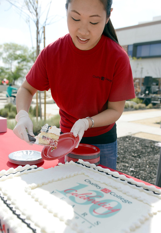 . Joanie Lin, 31 Nursing student, helps pass out cake at Chaffey College �130th� anniversary celebration in Rancho Cucamonga March 9, 2013.(Thomas R. Cordova/Staff Photographer)